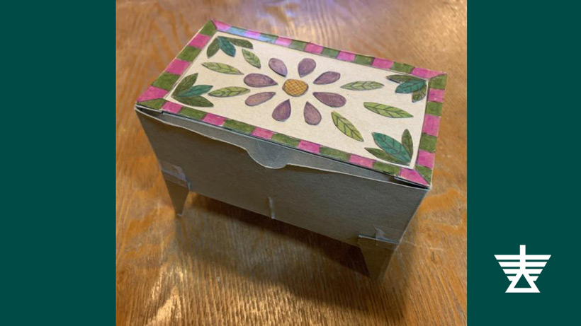Miniature chest made of paper with a floral pattern on top