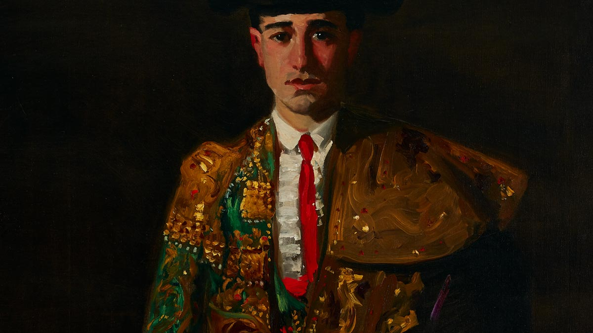 Matador wearing a colorful green and gold suit with red tie