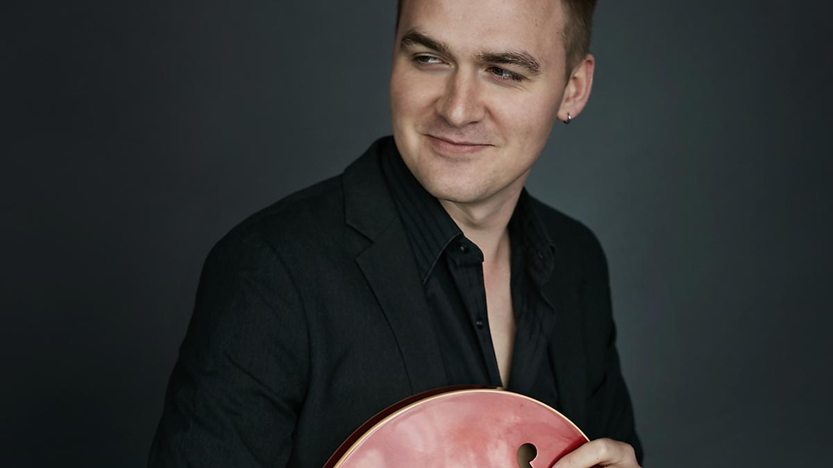 Photo of Kenny Reichert holding and instrument