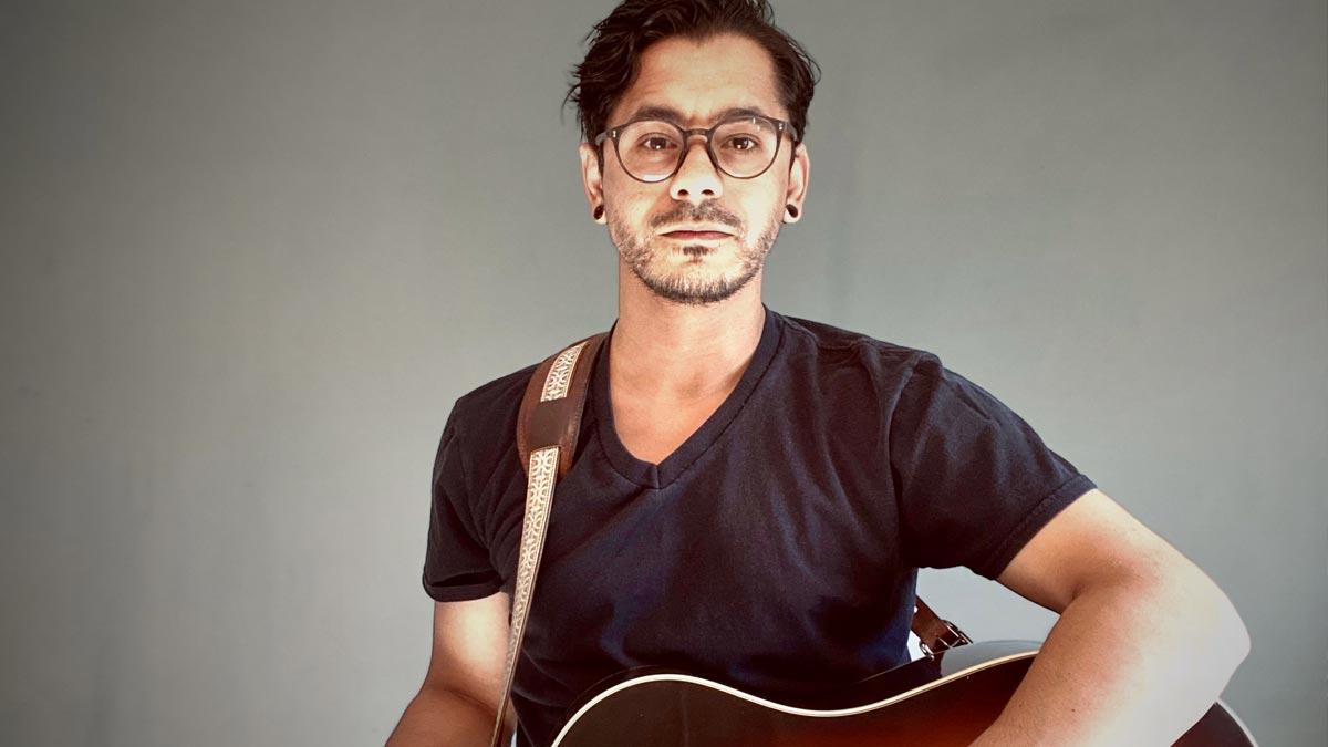 Profile image of Orlando Pena holding a guitar