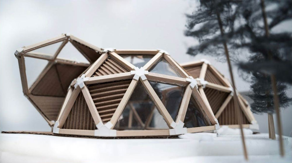 Dome style huse model covered in windows made of cardboard and other materials