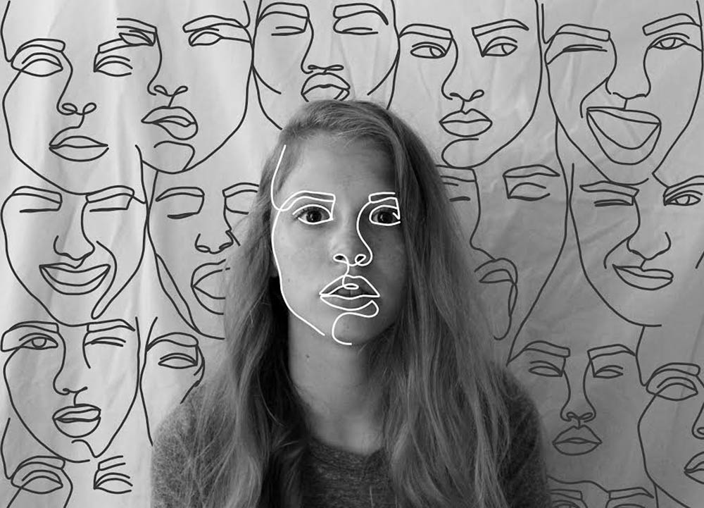 Black and white photo of a girl with a white outline of her face tiled in the background with multiple expressions