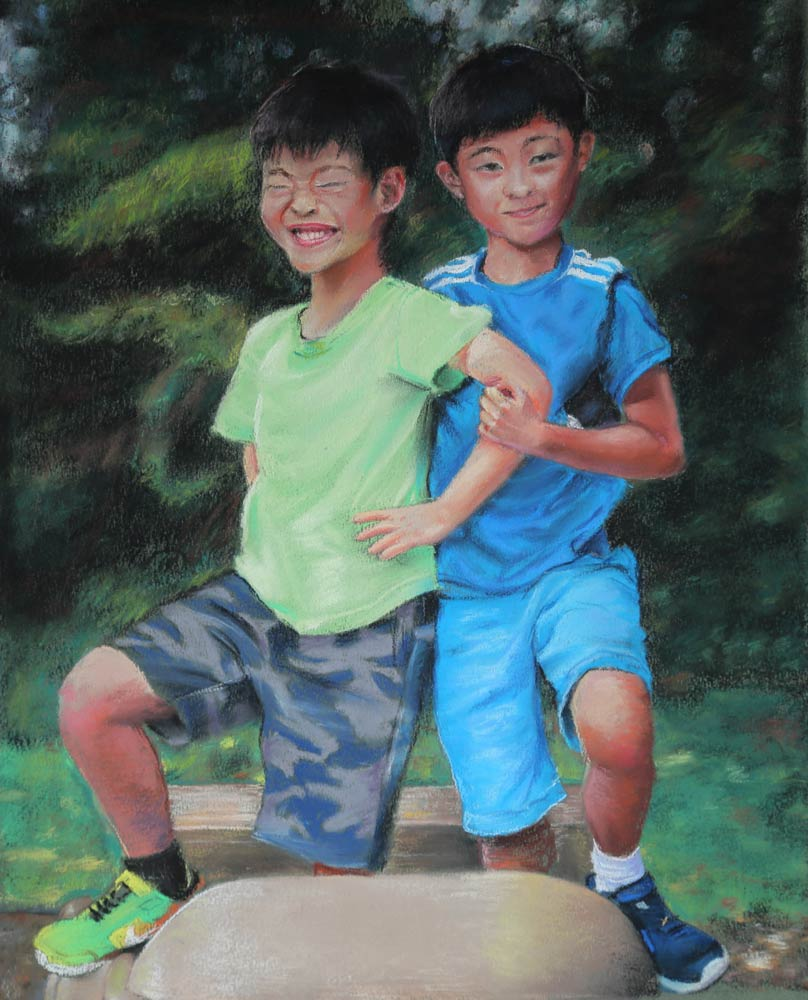Two young Asian boys posing together with their arms interlocked
