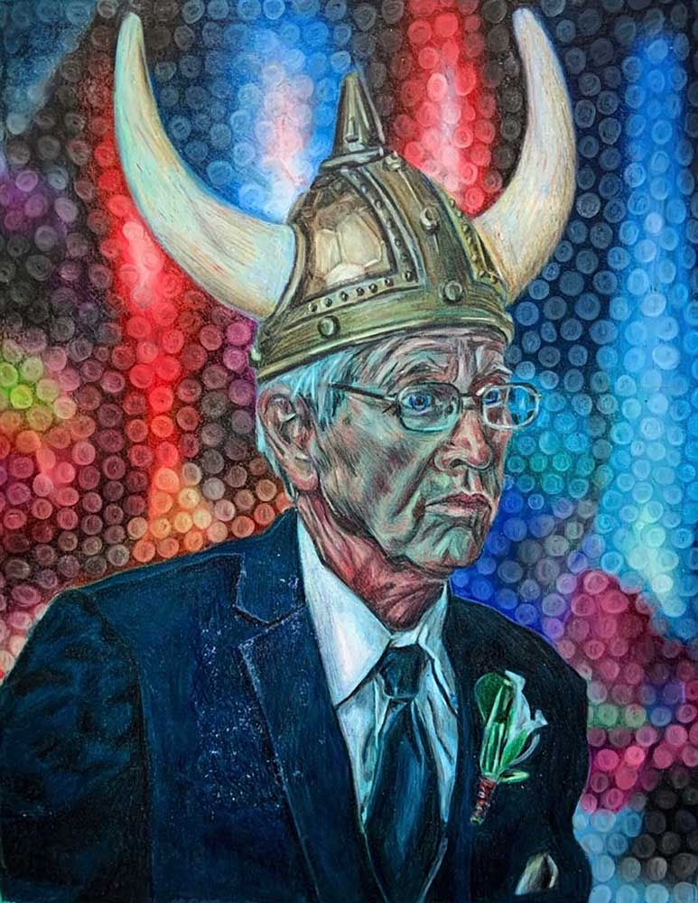 Edlerly man with glasses in a blue suite wearing a viking helmet with a rainbow of lights in the background