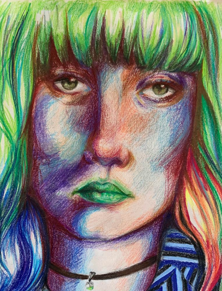 Portrait of a young woman with green and multi-colored hair