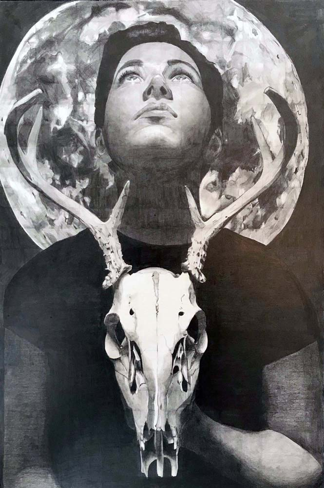 Girl holding a deer skull looking up at the moon
