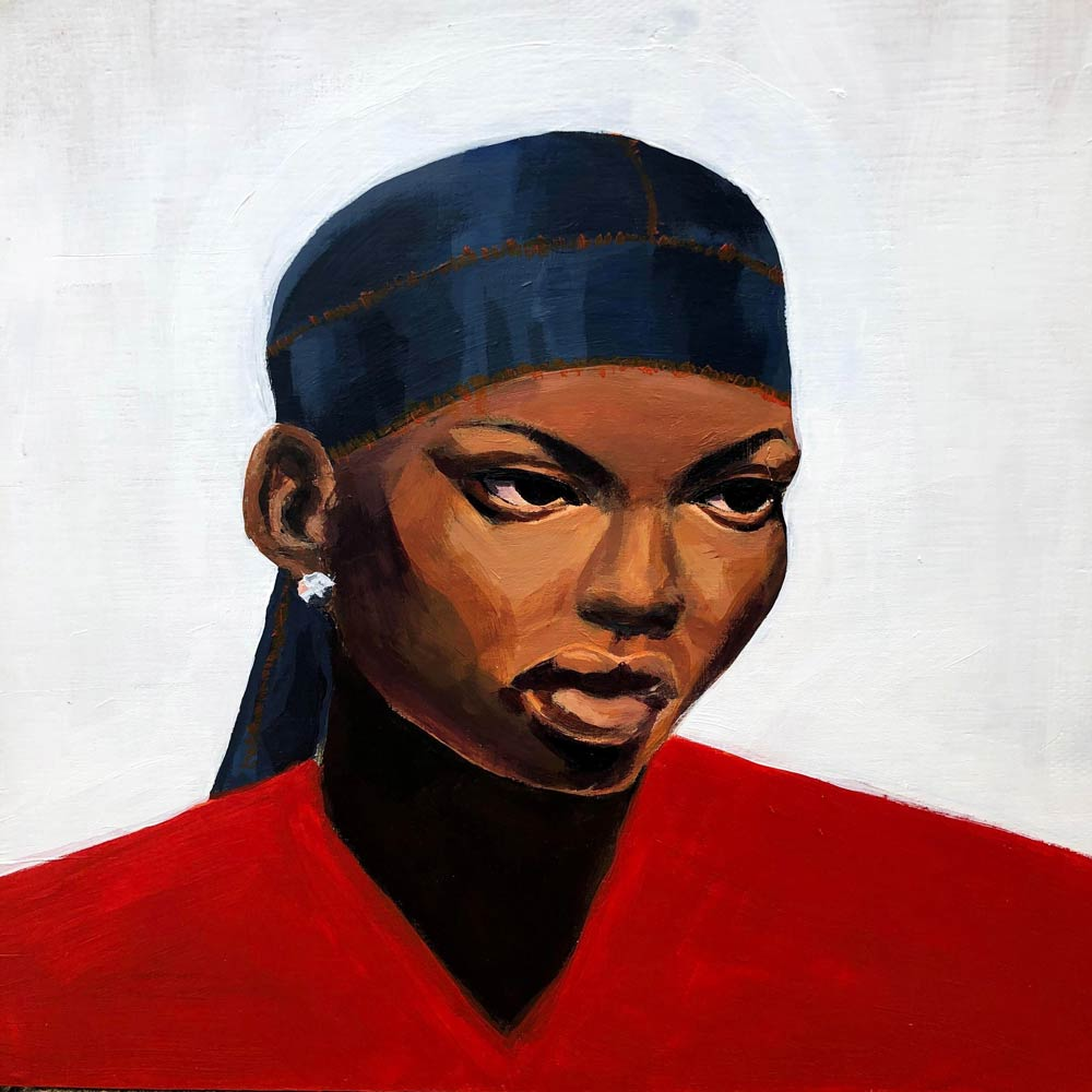 Young woman with a red shirt, silver earring, and a blue bandana covering her head