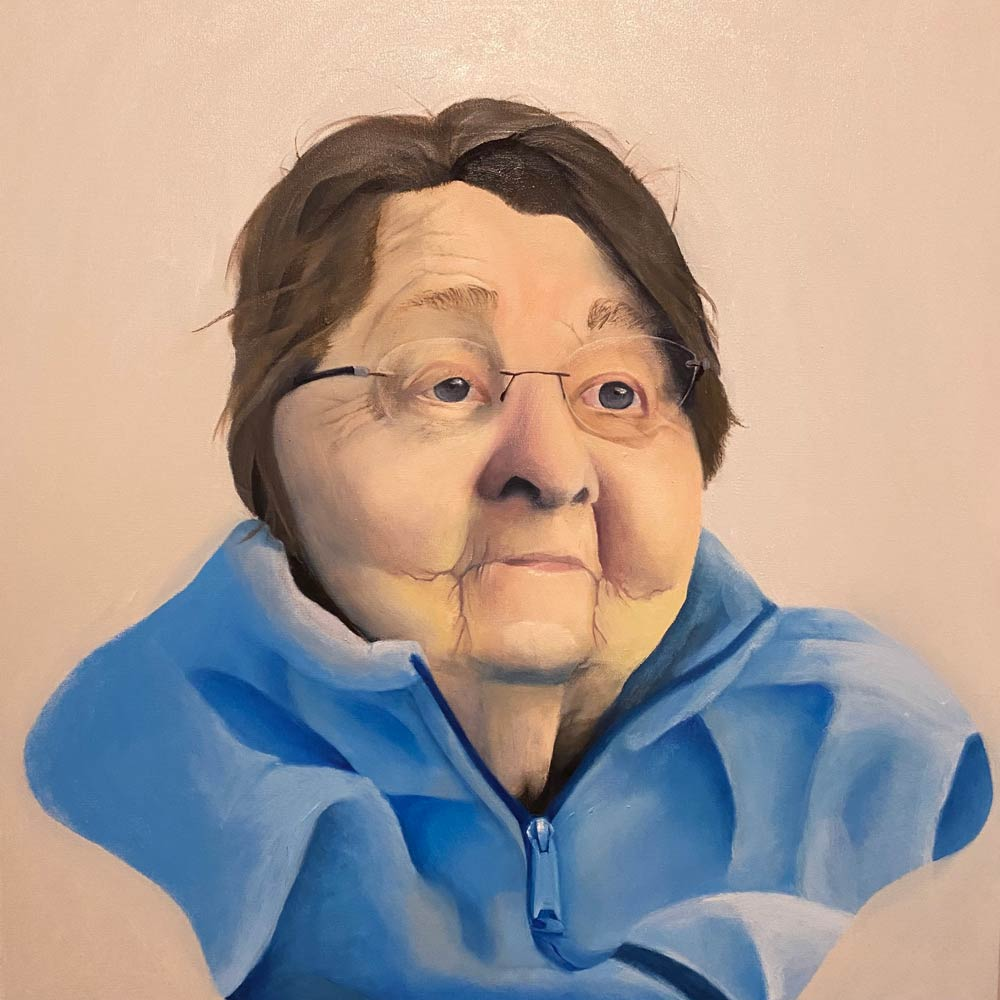 Elderly woman with chubby cheeks in a blue zip-up sweater