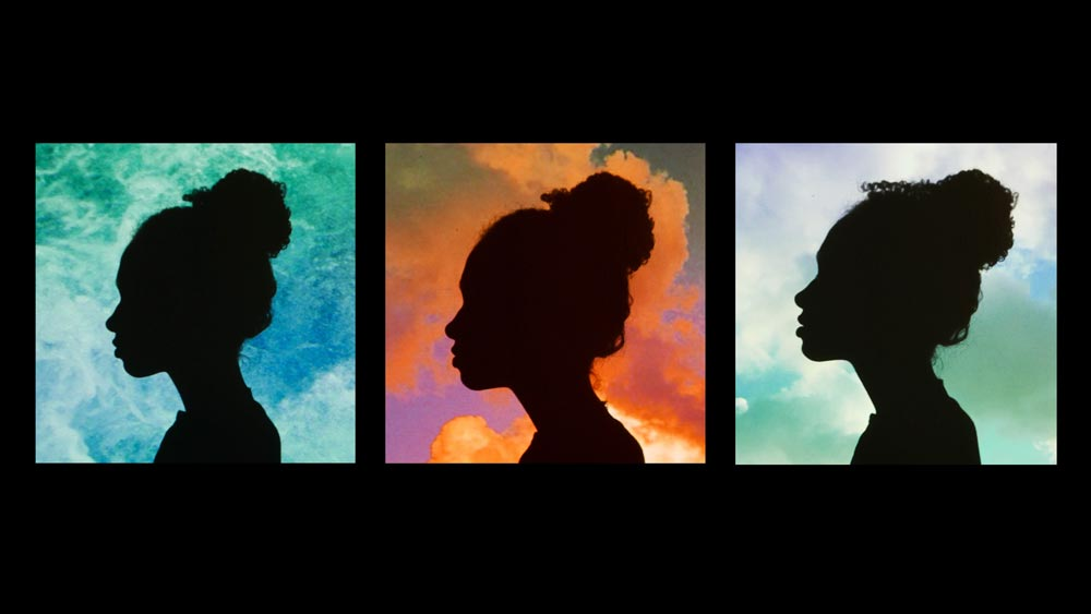 Three panes lined horizontally with the silhouette of a woman, one with a water background, one with a sunset and clouds background, and one with a blue sky with clouds background