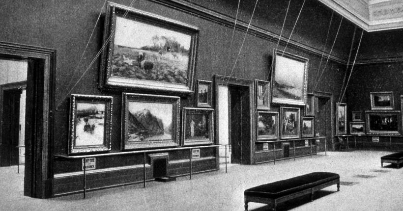 Historical photo of the Museum with barricades around art to avoid touching