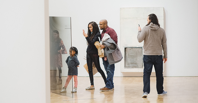Family taking pictures at the Museum